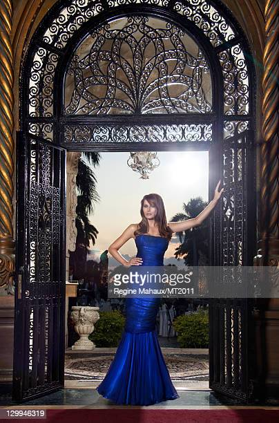 Melania Trump poses during a photo shoot at the MaraLago Club on March 26 2011 in Palm Beach Florida Melania's clothes by Chanel makeup by Tina...
