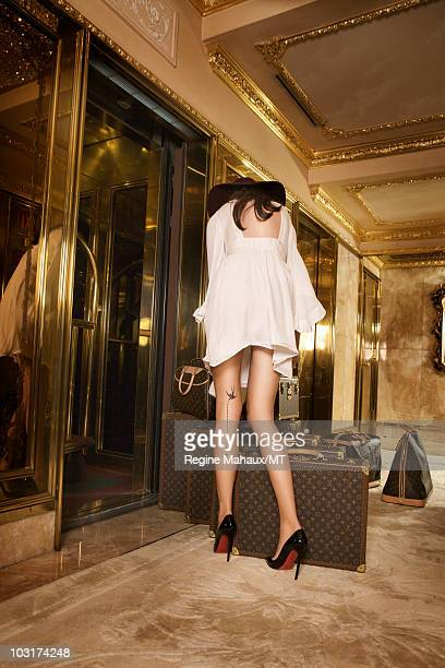 Melania Trump poses for a portrait on April 14, 2010 in New York City. Melania Trump is wearing a dress by Single, shoes by Christian Louboutian, hat...