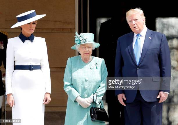 Melania Trump Queen Elizabeth II and US President Donald Trump attend the Ceremonial Welcome in the Buckingham Palace Garden for President Trump...