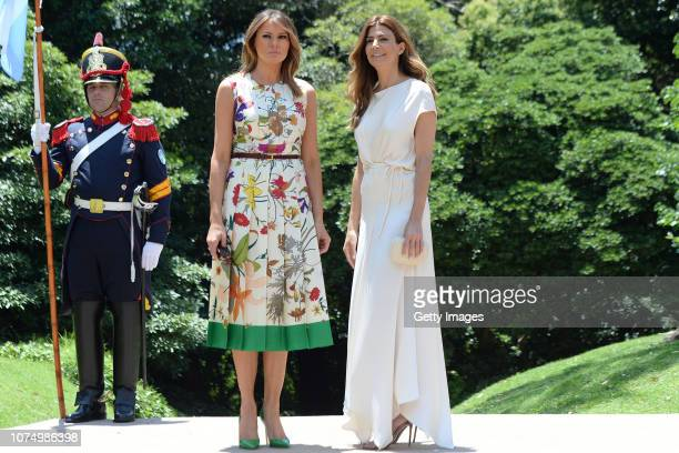 Melania Trump , US President Donal Trump's wife, and Juliana Awada, President of Argentina Mauricio Macri's wife, pose for pictures during a visit to...
