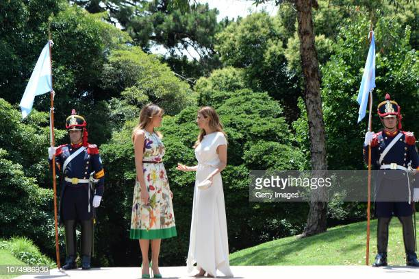 Melania Trump , US President Donal Trump's wife, greets Juliana Awada, President of Argentina Mauricio Macri's wife, during a visit to Villa Ocampo...