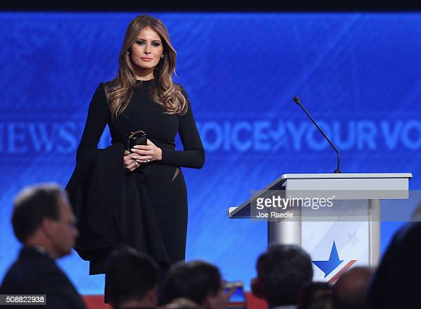 Melania Trump wife of Republican presidential candidate Donald Trump stands on stage following the Republican presidential debate at St Anselm...
