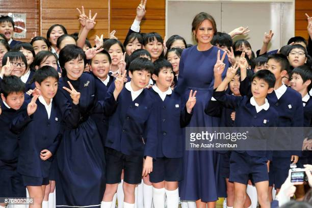 Melania Trump wife of US President Donald Trump and Akie Abe wife of Japanese Prime Minister Shinzo Abe pose for photographs with school children...