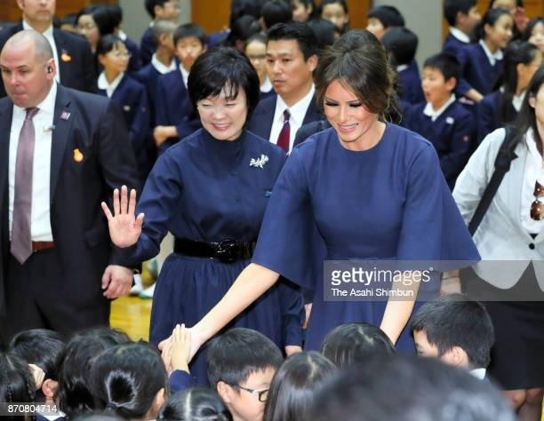 Melania Trump wife of US President Donald Trump and Akie Abe wife of Japanese Prime Minister Shinzo Abe talk with school children during their visit...