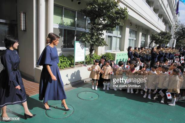 Melania Trump wife of US President Donald Trump and Akie Abe wife of Japanese Prime Minister Shinzo Abe are seen off by school children after their...