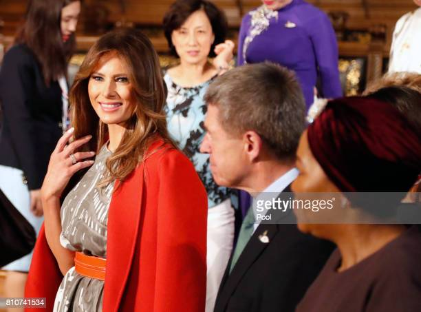 Melania Trump wife of US President Donald Trump Joachim Sauer husband of German Chancellor Angela Merkel and Thobeka MadibaZuma wife of the South...