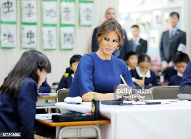 Melania Trump wife of US President Donald Trump takes part in a Japanese calligraphy session during the visit to Kyobashi Tsukiji Elementary School...