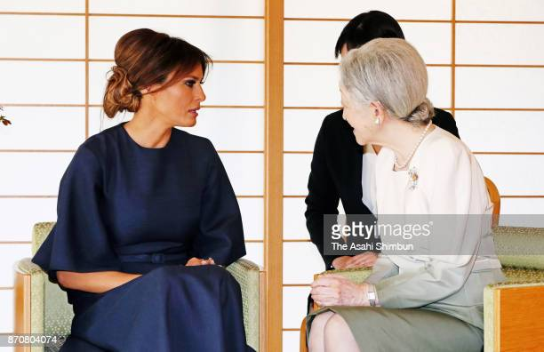 Melania Trump wife of US President Donald Trump talks with Empress Michiko during their meeting at the Imperial Palace on November 6 2017 in Tokyo...