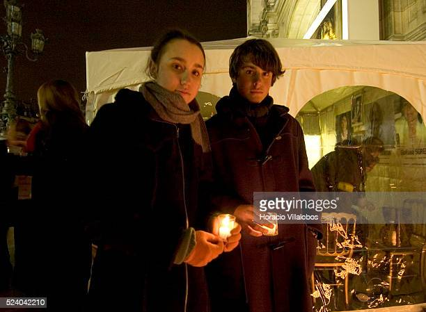 Melanie and Lorenzo Delloye-Betancourt, daughter and son of Colombian politician Ingrid Betancourt, hold candles in front of the Paris Hotel de Ville...