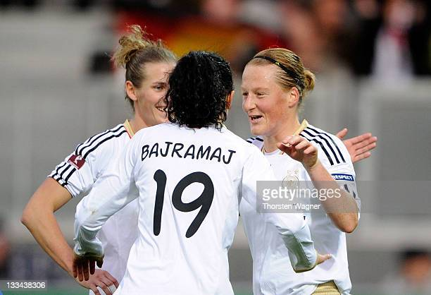Melanie Behringer celebrates with her team mates Fatmire Bajramaj and Simone Laudehr after scoring her teams nineth goal wit a penalty during the...