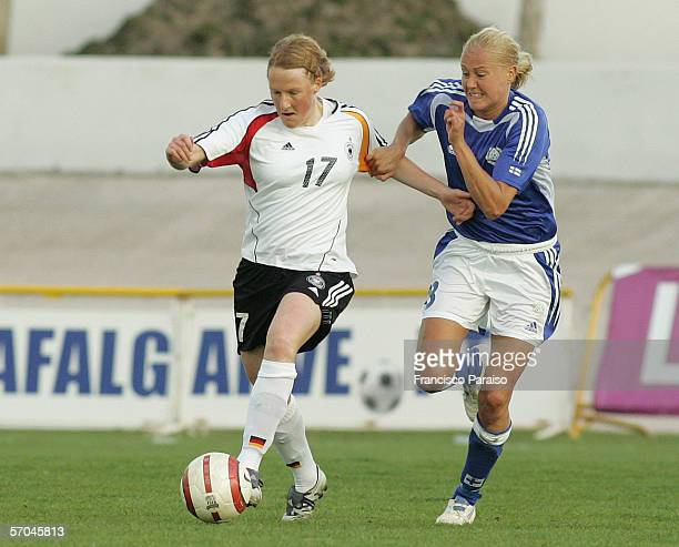 Melanie Behringer of Germany and Minna Mustonen of Finland battle for the ball during the Womens Algarve Cup match between Germany and Finland on...