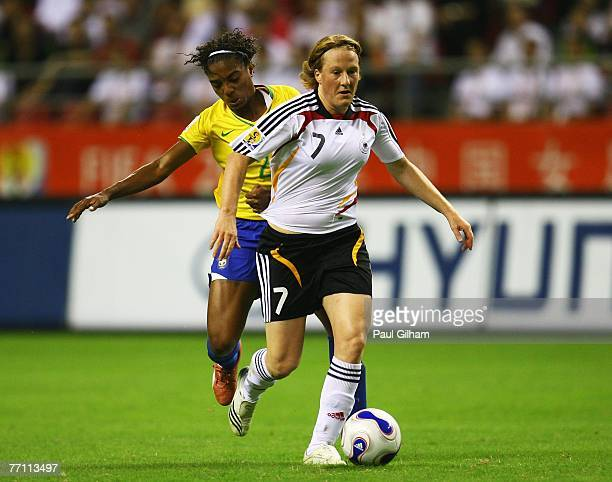 Melanie Behringer of Germany battles for the ball with Elaine Estrela Moura of Brazil during the Women's World Cup 2007 Final between Brazil and...
