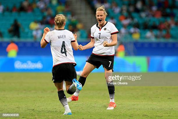 Melanie Behringer of Germany celebrates after scoring the opening goal during the Women's Football Quarterfinal match between China and Germany on...
