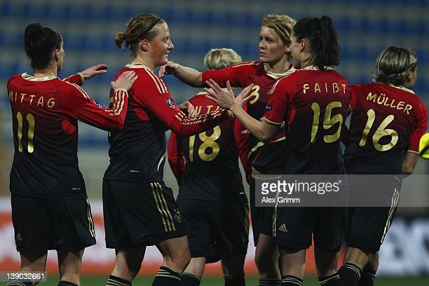 Melanie Behringer of Germany celebrates her team's fifth goal with team mates during the Women's Euro Qualifier between Turkey and Germany at Buca...