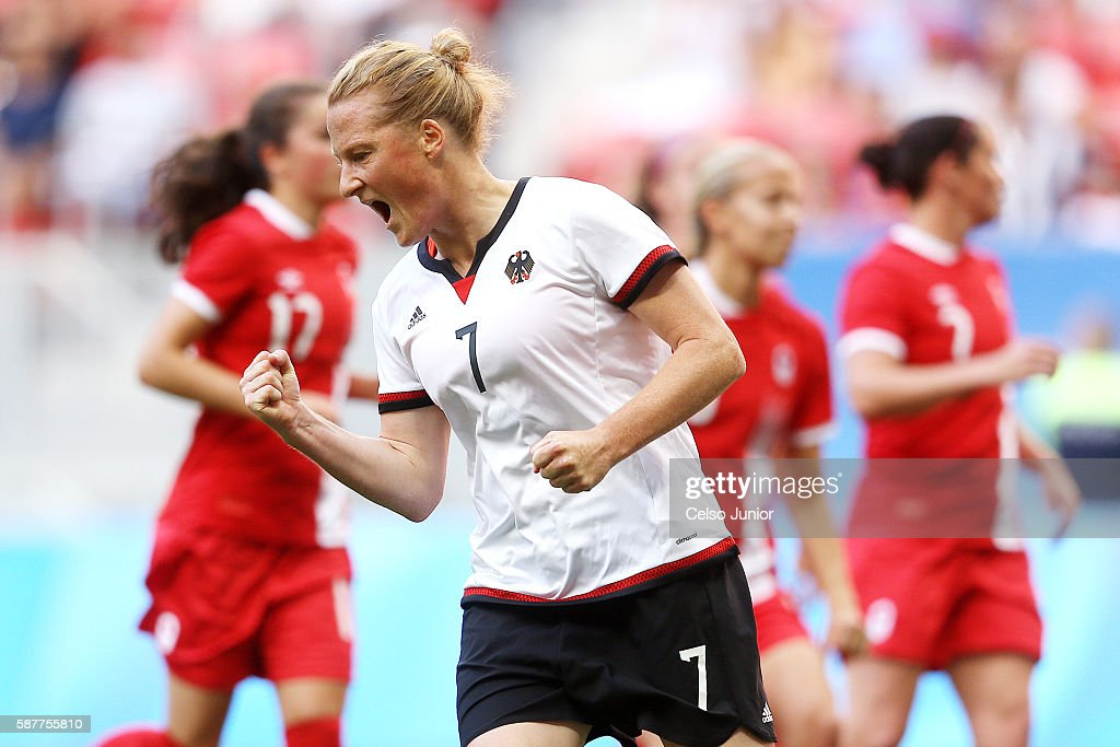 Melanie Behringer of Germany celebrates scoring her team's first goal during the Women's First Round Group F match between Germany and Canada on Day 4 of the Rio 2016 Olympic Games at Mane Garrincha Stadium on August 9, 2016 in Brasilia, Brazil.