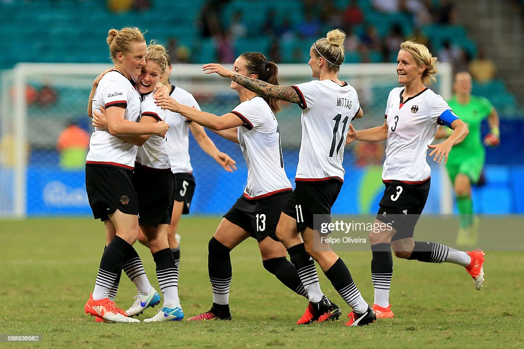Melanie Behringer (L) of Germany celebrates with team mates after scoring the opening goal during the Women's Football Quarterfinal match between China and Germany on Day 7 of the Rio 2016 Olympic Games at Arena Fonte Nova on August 12, 2016 in Salvador, Brazil.