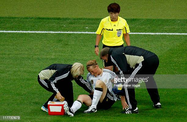 Melanie Behringer of Germany is injured during the FIFA Women's World Cup 2011 Group A match between Germany and Nigeria at FIFA World Cup stadium...
