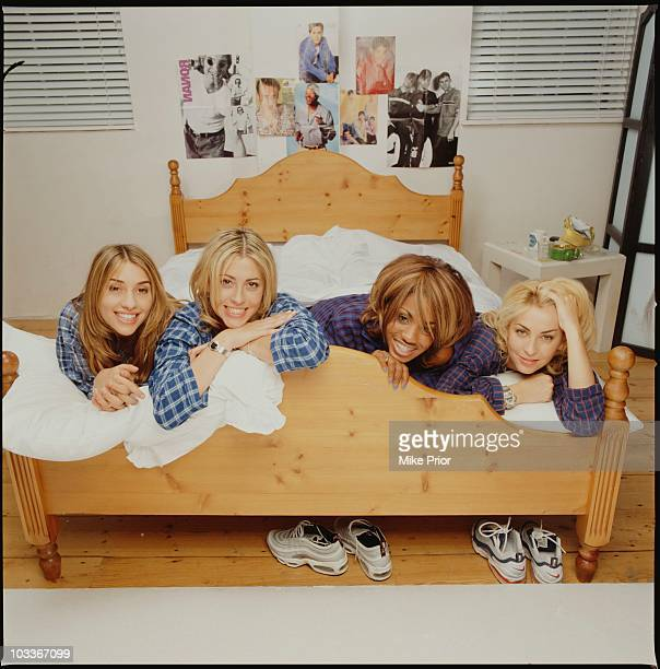 LR Melanie Blatt Nicole Appleton Shaznay Lewis Natalie Appleton of All Saints posed on a bed in a London photographic studio in 1997