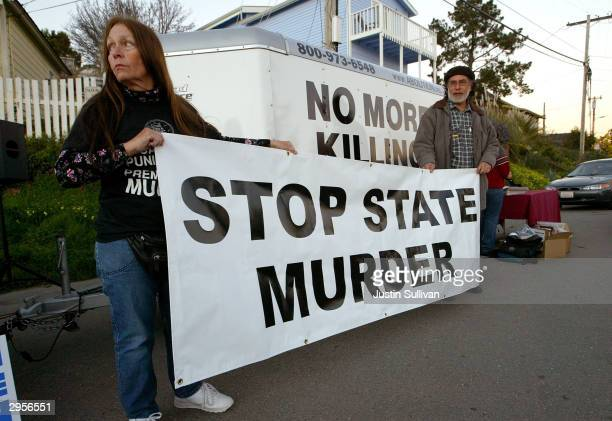 Melanie Bostic of Lancaster California and Michael Wharton of San Leandro California hold a sign outside of the California State Prison at San...