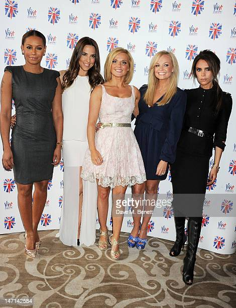 Melanie Brown aka Mel B, Melanie Chisholm aka Mel C, Geri Halliwell, Emma Bunton and Victoria Beckham pose at the press launch of 'Viva Forever', a...