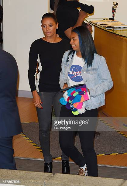 Melanie Brown and her daughter Phoenix Brown leave the X Factor studio on October 25 2014 in London England