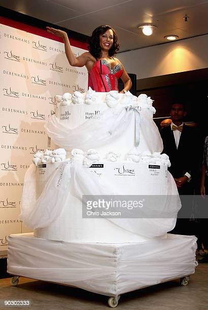 Melanie Brown bursts out of a giant birthday cake to celebrate Ultimo's 10th Birthday and lauch her underwear range at Debenhams on September 2 2009...