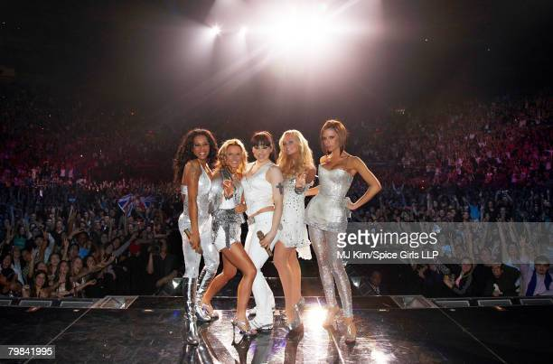 ACCESS *** Melanie Brown Geri Halliwell Melanie Chilsolm Emma Bunton and Victoria Beckham of The Spice Girls pose on stage during The Return of Spice...