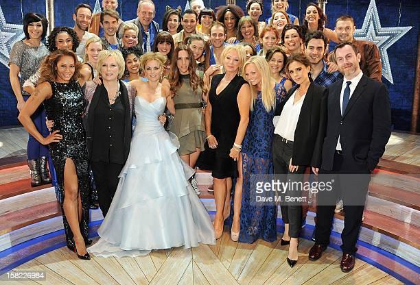 Melanie Brown, Jennifer Saunders, Geri Halliwell, Melanie Chisholm, Judy Craymer, Emma Bunton, Victoria Beckham and director Paul Garrington pose...