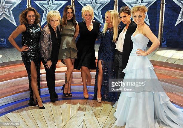 Melanie Brown, Jennifer Saunders, Melanie Chisholm, Judy Craymer, Emma Bunton, Victoria Beckham and Geri Halliwell pose backstage at the Gala Press...