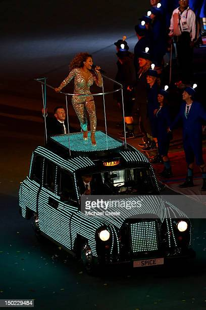 Melanie Brown of the Spice Girls performs on the roof of a black taxi during the Closing Ceremony on Day 16 of the London 2012 Olympic Games at...