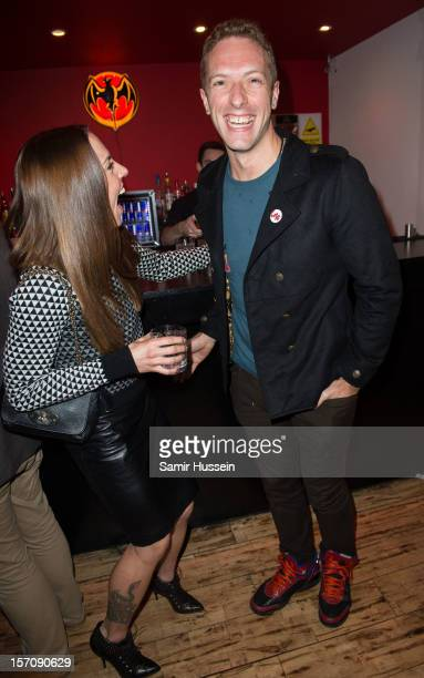 Melanie Chisholm and Chris Martin of Coldplay attend the private view of Coldplay Paris And Kids Company an exhibition showcasing work from the...