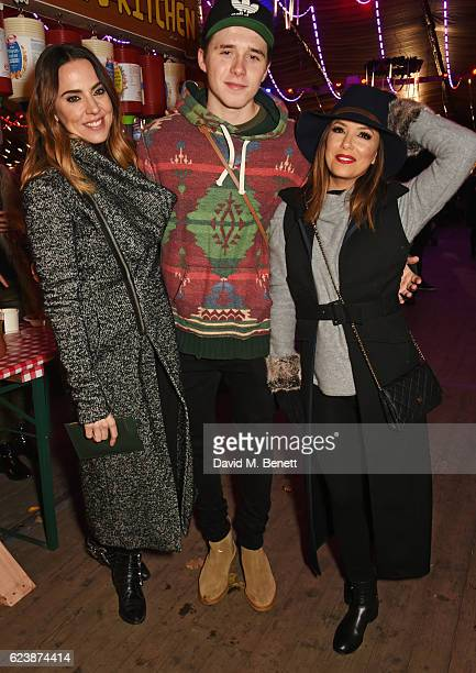 Melanie Chisholm Brooklyn Beckham and Eva Longoria attend a VIP Preview of Hyde Park's Winter Wonderland 2016 on November 17 2016 in London United...