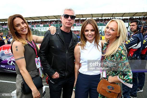 Melanie Chisholm John Giddings Geri Horner and Emma Bunton pose on the grid before the Formula One Grand Prix of Great Britain at Silverstone Circuit...