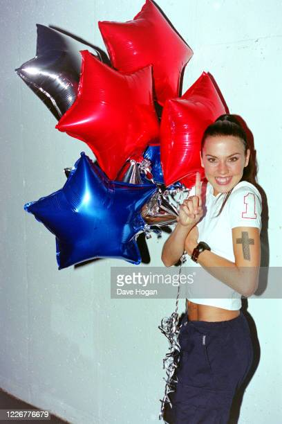 Melanie Chisholm of The Spice Girls celebrate as their single Viva Forever goes to number one in the charts, their seventh number one record, London,...