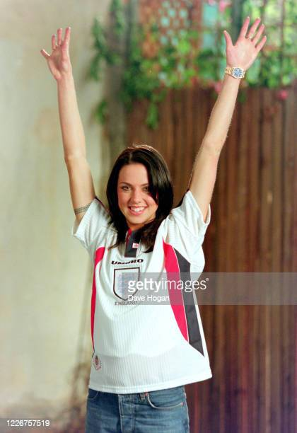 """Melanie Chisholm of The Spice Girls wearing an England shirt to record the video for the single """" On Top of the World"""", England's official song for..."""