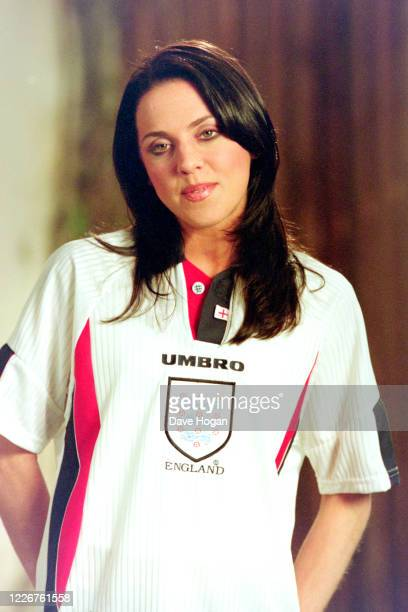"""Melanie Chisholm of The Spice Girls wearing an England shirt while recording the video for the single """" On Top of the World"""", England's official song..."""