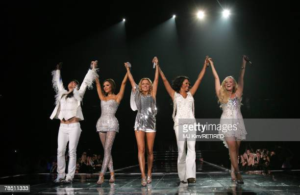 Melanie Chisholm, Victoria Beckham, Geri Halliwell, Melanie Brown and Emma Bunton of Spice Girls perform during the first concert of the UK leg of...