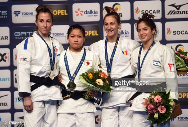 Melanie Clement Funa Tonaki Monica Ungureanu and Noa Minsker on the victors' podium after competing in 48 kilo category at the Judo Grand Prix in the...