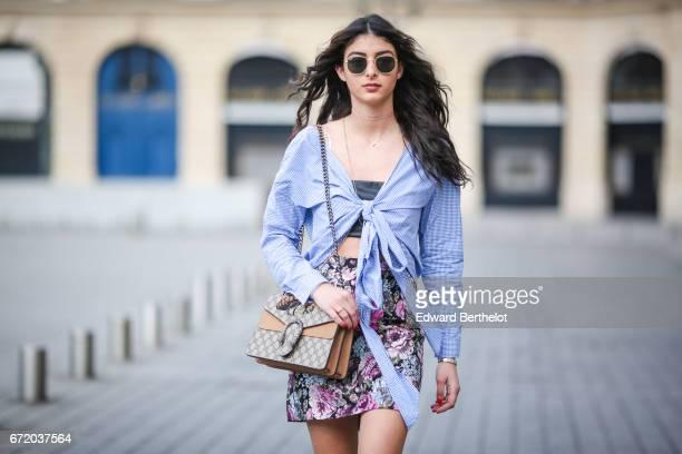 Melanie Darmon fashion blogger wears an HM blue striped shirt black bras an HM flower print skirt RayBan sunglasses Chloe shoes and a Gucci bag at...