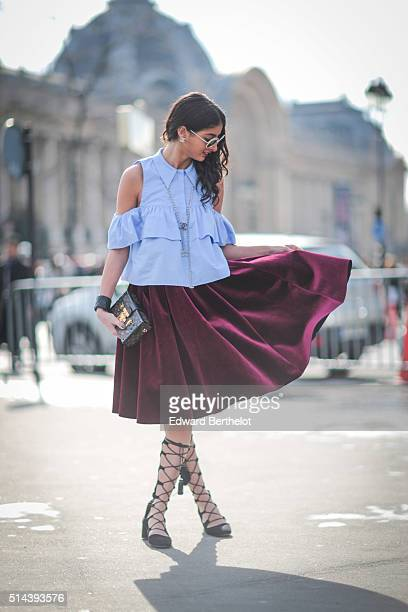 Melanie Darmon is wearing a Zara top Zara shoes a Maje skirt and a Louis Vuitton bag after the Chanel show during Paris Fashion Week Womenswear Fall...