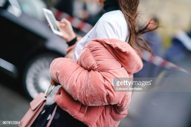 Melanie Darmon wears sunglasses a pink puffer coat a white tshirt a black lace mesh skirt with polka dots outside Dior during Paris Fashion Week...