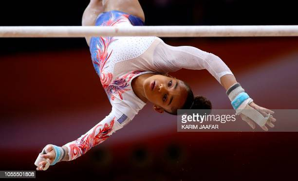 TOPSHOT Melanie de Jesus dos Santos of France competes in the uneven bar during women's team final of the 2018 FIG Artistic Gymnastics Championships...