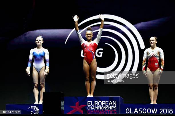 Melanie De Jesus of France Denisa Golgota of Romania and Axelle Klinckaert of Belgium are presented with their medals in the Women's Individual Floor...