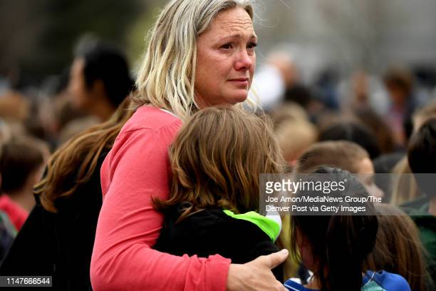 Melanie Fitzroy an AM Elementary EA comforts a child after a shooting at the STEM School Highlands Ranch on May 7 in Highlands Ranch Colorado She has...
