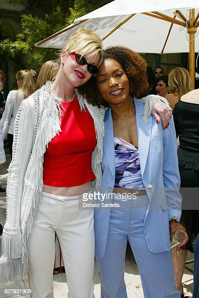 Melanie Griffith and Angela Bassett during Versace Luncheon to Benefit Children's Action NetworkWestside Children's Center Sponsored By InStyle...