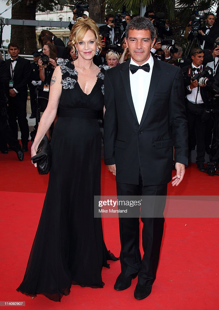 Melanie Griffith (L) and Antonio Banderas arrive at the Midnight In Paris' Premiere part of the 64th Cannes Film Festival at Palais des Festivals on May 11, 2011 in Cannes, France.
