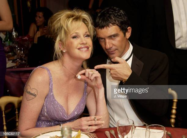 Melanie Griffith and Antonio Banderas during Cannes 2002 'Femme Fatale' Dinner at Le Dome Carlton Hotel in Cannes France