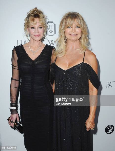 Melanie Griffith and Goldie Hawn arrive at amfAR Los Angeles 2017 at Ron Burkleâs Green Acres Estate on October 13 2017 in Beverly Hills Californi