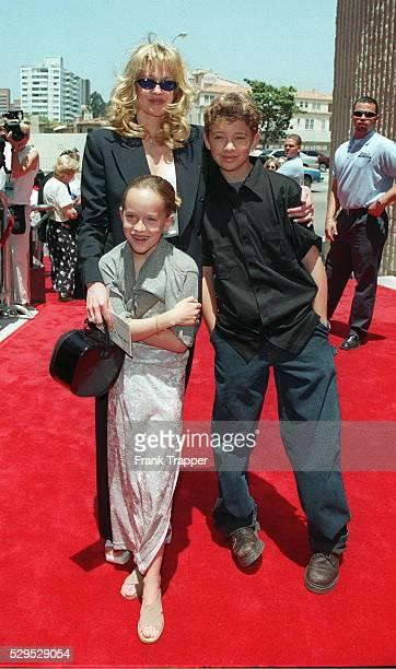 Melanie Griffith arriving with her children Dako ta Johnson and Alexander Bauer