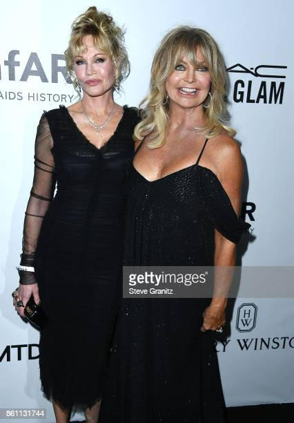 Melanie Griffith Goldie Hawn arrives at the amfAR Los Angeles 2017 at Ron Burkleâs Green Acres Estate on October 13 2017 in Beverly Hills Californi